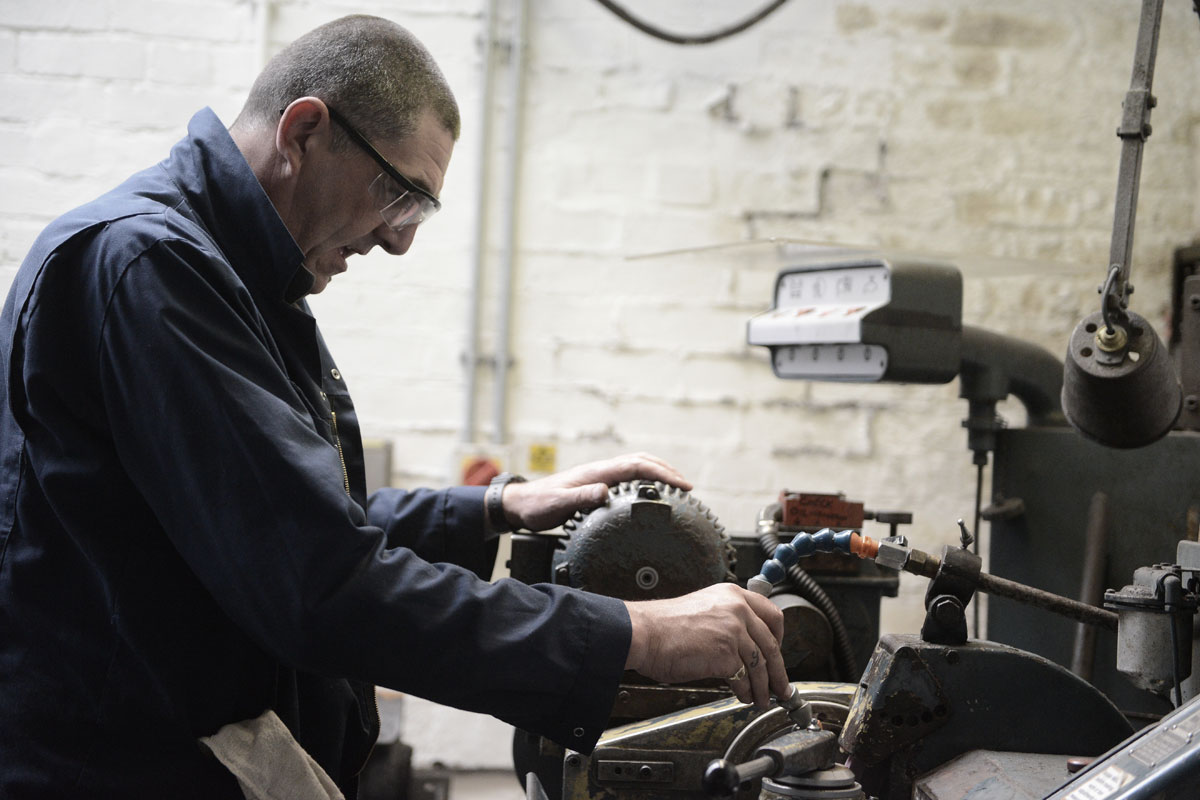 Gear manufacturing man at work