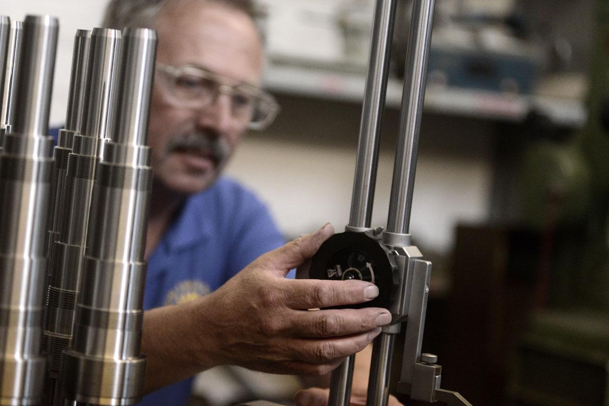 Gear manufacturing man fixing