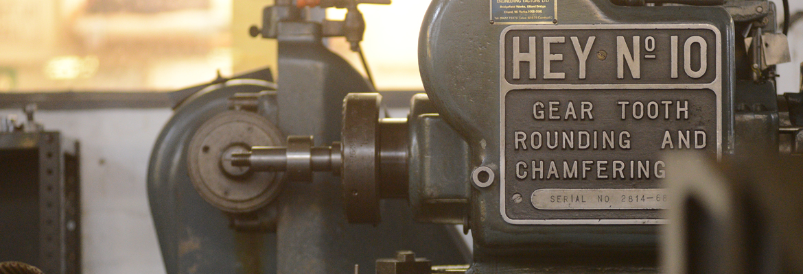 Gear manufacturing machine gear tooth rounding and chamfering